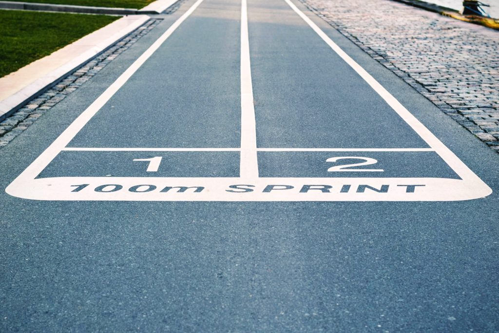 photo of the finish line of 100 meter sprint track